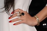 Nicole Scherzinger mixed feminine with punk with this gold ring with diamond spikes.
