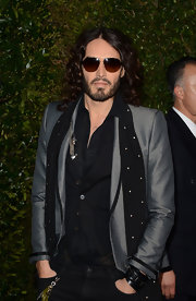 Russell Brand stuck to his signature rock and roll style with a silver blazer with black trim.