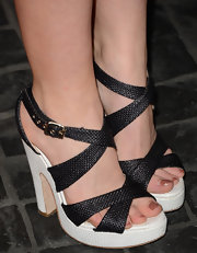 Levin Rambin showed off her polished pedicure with black and white strappy, platform sandals.