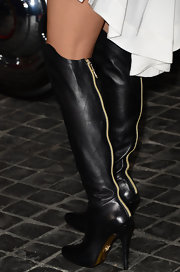Nicole Scherzinger showed her edgier style with black knee-high leather boots with a classic gold zipper in the back.