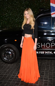 Lydia Hearst dressed up her black crop top by pairing it with a maxi skirt and statement necklace.