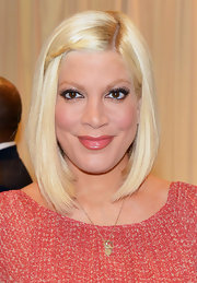 Tori Spelling wore her classic bob with a cute slim braid while signing copies of her new book.