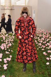 Anna Wintour was on theme in her floral coat while checking out the garden-inspired set at the Tory Burch fashion show.