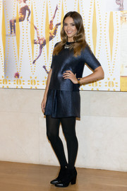 Jessica Alba attended the Tory Burch in Color event wearing a sporty-chic metallic-blue knit top from the brand.