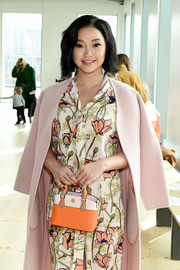 Lana Condor's bold red mani totally popped against her pastel outfit at the Tory Burch fashion show.