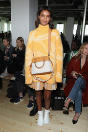 Liya Kebede styled her outfit with a two-tone leather cross-body bag.