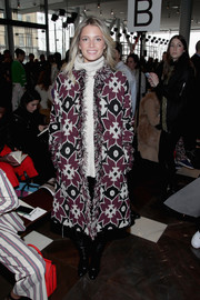 Helena Bordon kept warm in vibrant style with this printed coat by Tory Burch during the brand's fashion show.