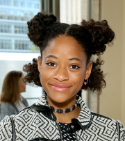 Kilo Kish looked quirky with her afro puffs at the Tory Burch fashion show.