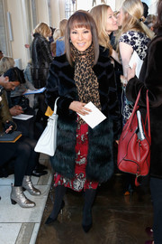 Alino Cho looked totally luxe in a black fur coat during the Tory Burch fashion show.