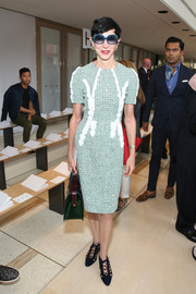 Amy Fine Collins attended the Tory Burch fashion show wearing  a green tweed dress.