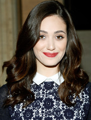 Emmy Rossum styled her hair with lush curls for the Tory Burch fashion show.