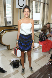 Leandra Medine looked very summery in a white silk camisole during the Tory Burch fashion show.
