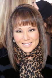Alina Cho looked hip at the Tory Burch fashion show with her graduated hairstyle and blunt bangs.