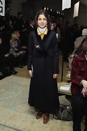 Leandra Medine was Russian-chic in a long, fur-trimmed navy coat during the Tory Burch fashion show.