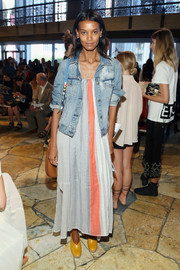 Liya Kebede kept it relaxed in a loose print dress while attending the Tory Burch fashion show.