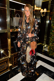 Anna dello Russo attended the Tory Burch Paris flagship opening sporting a floor-sweeping floral-embroidered dress by Chloe.