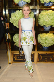 Kiernan Shipka teamed her top with a pair of white Tory Burch slacks, featuring the same charming floral embroidery.