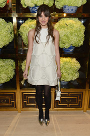 Hailee Steinfeld added shine to her ensemble via silver Tory Burch pumps.