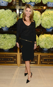 Lori Loughlin was casual yet sophisticated in a sheer black scoopneck sweater during the Tory Burch Rodeo Drive opening.