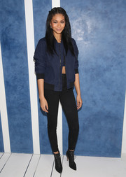 Chanel Iman toughened up in a blue bomber jacket by Tory Sport for the brand's store opening.
