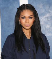 Chanel Iman wore her hair in a half-up style with small braids on either side of her face when she attended the Tory Sport store opening.