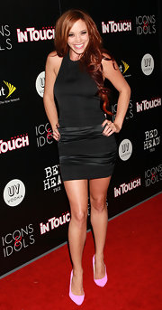 Jessica hit the red carpet with fiery red locks curled to her waist.