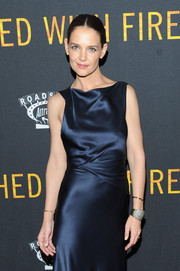 Katie Holmes paired her navy gown with a sparkling cuff bracelet for the New York premiere of 'Touched with Fire.'