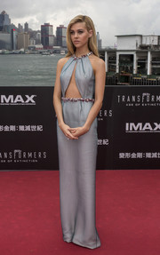 Nicola Peltz oozed major sex appeal in an icy-blue Prada cutout dress at the 'Transformers: Age of Extinction' screening in Hong Kong.