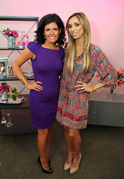 Giuliana wore an wrap-around leather bracelet with her print dress for the 'Treasure Your Chest' event.