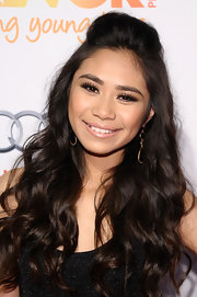 Jessica Sanchez opted for a dewy and fresh look with this nude lip gloss.