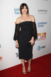 Kathryn Hahn complemented her LBD with skinny-strap sandals by Tamara Mellon.