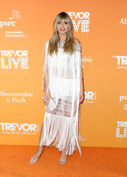 Heidi Klum looked sassy in a fringed sheer-panel white dress by Julien Macdonald at TrevorLIVE LA 2019.