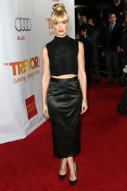 Beth Behrs went for an all-black finish, teaming her top with a pencil skirt and pumps.