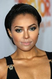 Kat Graham wore metallic blue eyeshadow for a striking beauty look.