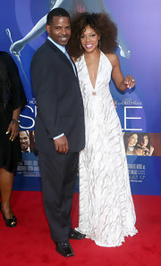 Wendy Raquel Robinson looked tantalizing in a white and silver halter dress with a down-to-there neckline.