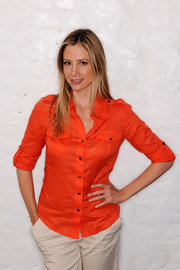 Mira Sorvino brought a bright pop of color to the Tribeca Film Festival with her orange button-down shirt.