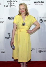 Elisabeth Moss was a drop of sunshine in this yellow midi dress by Miu Miu that she paired with Eva Fehren jewelry at the Tribeca Film Fest premiere of 'Tokyo Project.'
