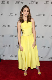 Emmy Rossum went all out with the colors, pairing her dress with yellow, white, and turquoise T-strap sandals by Christian Louboutin.