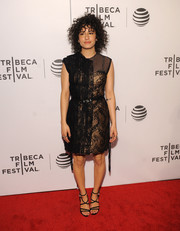 Strappy black heels sealed off Ilana Glazer's look.