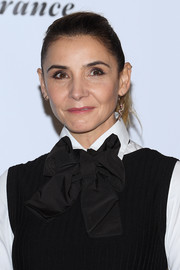 Clotilde Courau sported a brushed-back ponytail at the 12th Film Festival Lumiere.