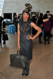 June Ambrose was spotted carrying an oversized leather bag at the Tribute to Versailles Models.