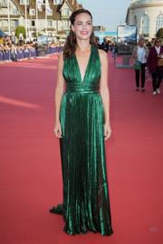 Berenice Bejo looked stunning in a pleated emerald gown by Elie Saab at the Deauville American Film Festival premiere of 'Good Time.'