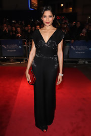 Freida Pinto was shining at the London Film Festival in a black jumpsuit with a deep-v and drapy wide legs.