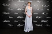 Elizabeth Debicki looked regal in a crystal-adorned slate-blue gown by Miu Miu at the Trophee Chopard photocall during Cannes.