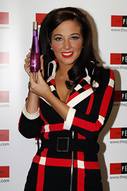 At her perfume launch, Tulisa Contostavlos brought a 60s vibe to her look that was carried from her dress, to her cat-eye liner and false lashes to her bouncy tresses and headband.