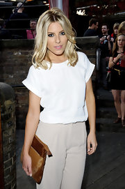 Mollie King attended the British Heart Foundation party carrying a suede clutch in two shades of brown.