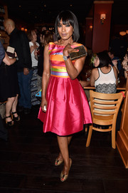 Angela Bassett looked absolutely refreshing at the Comic-Con cocktail party in a silk cocktail dress with a multicolored bodice.