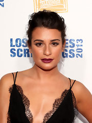 Lea Michele complemented her dewy golden skin with a big and bold raspberry lipstick.