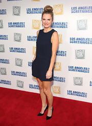 Maggie Lawson rocked a sleeveless navy romper for her look on the red carpet.