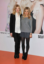 Sienna Miller got a boost at the Twenty8Twelve launch from black leather platform ankle boots.